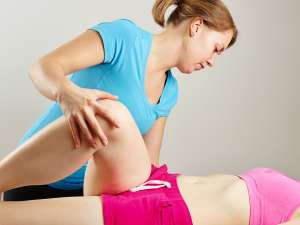 Osteopathy treatment the professional masseur and his patient